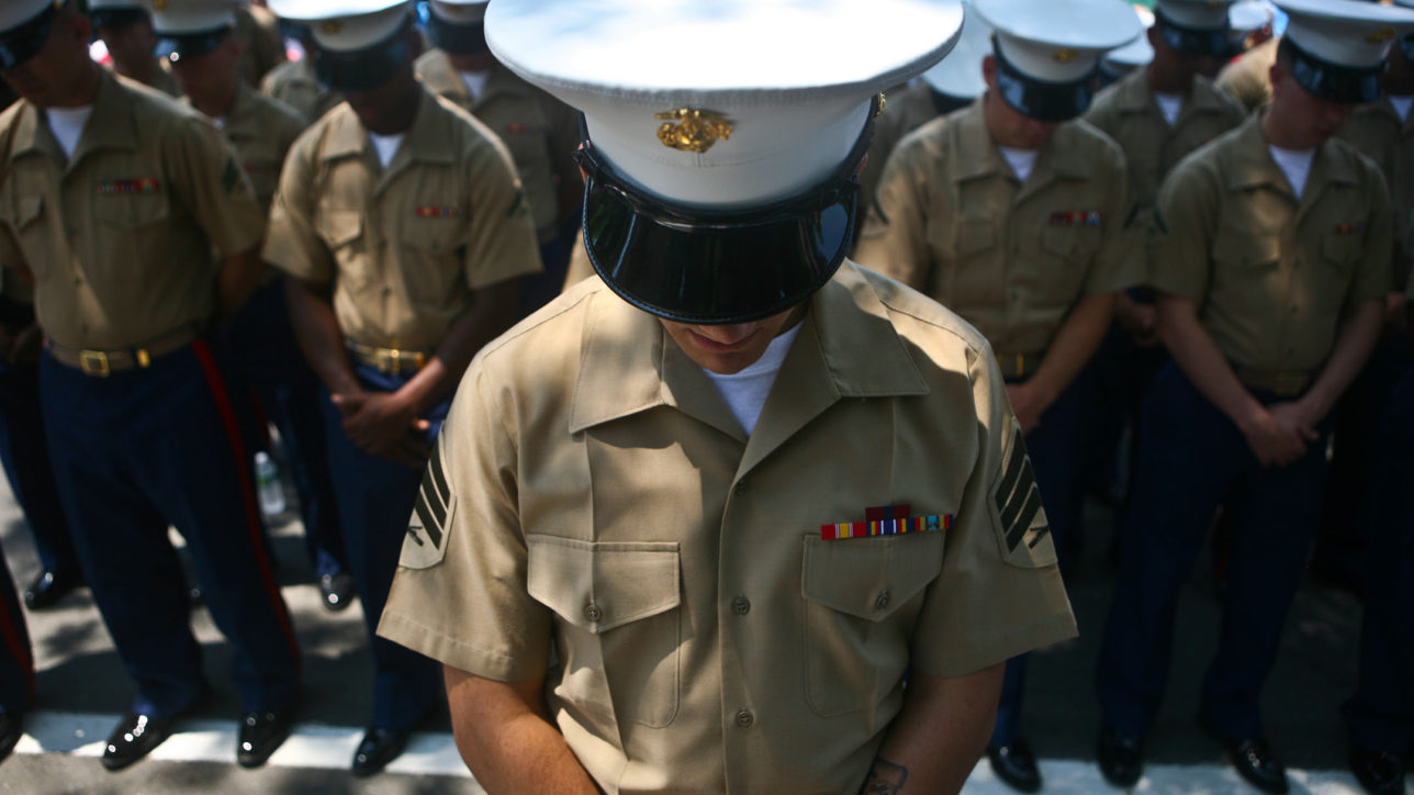 PELHAM, N. Y. - Special Purpose Marine Air Ground Task Force New York Marines bow their heads during the invocation ahead of Memorial Day ceremonies in Pelham, N.Y May 31. The Marines marched through town with sailors, retired veterans, fire fighters and police.  The Marines were on hand as part of Fleet Week New York 2010. This is the 26th year New York City has hosted the sea services for Fleet Week.