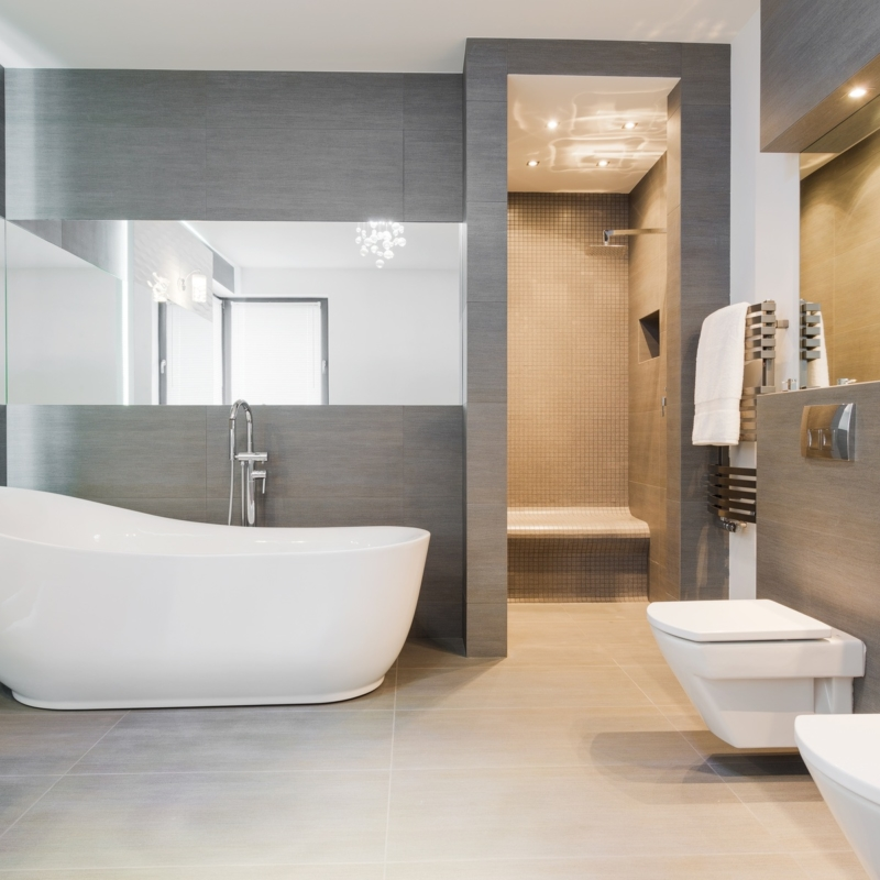 Freestanding bath in modern bathroom.