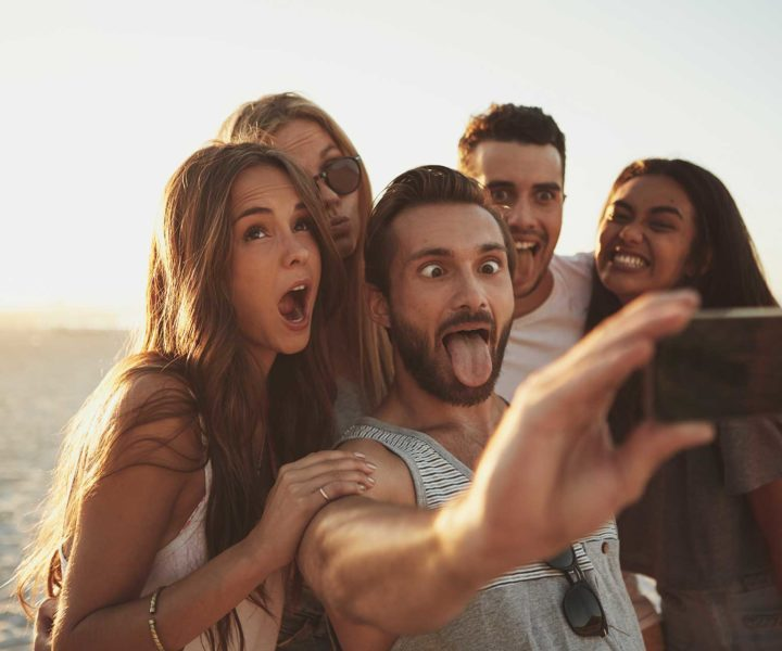 A group of friends taking a selfie on the beach